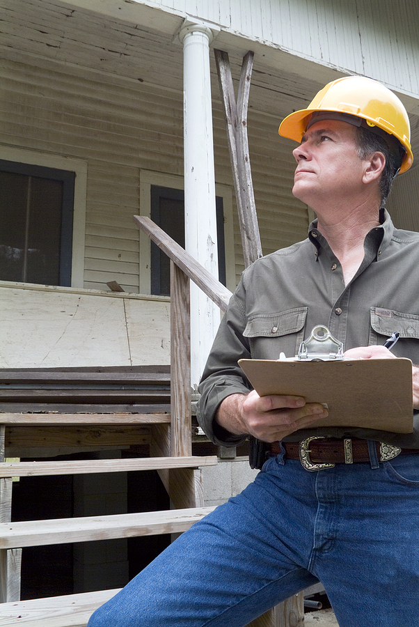 A man while creating a house building report