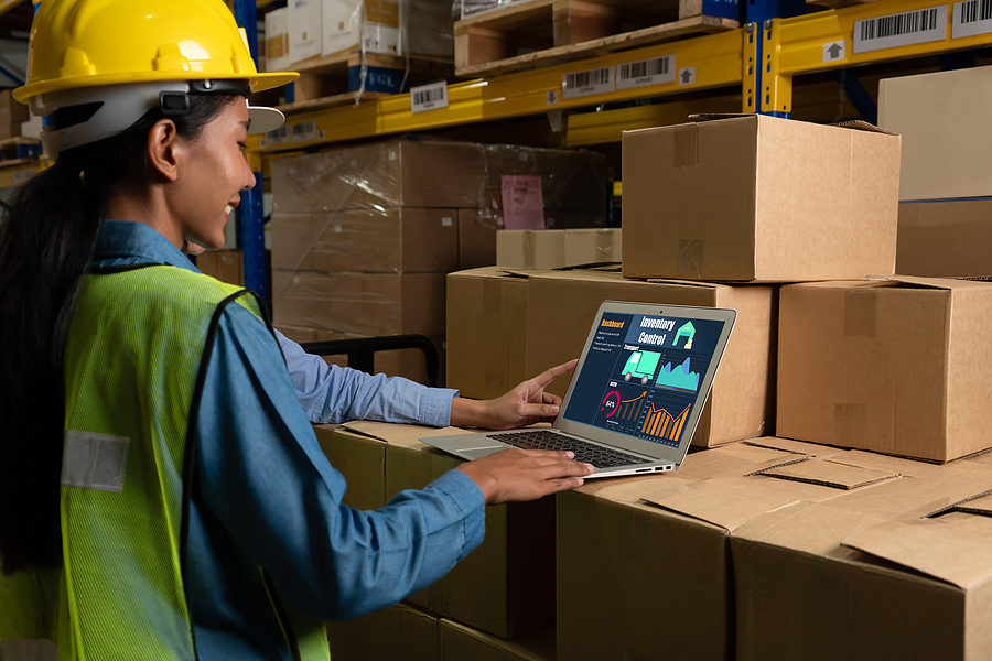 Warehouse worker using an ERP System for small businesses